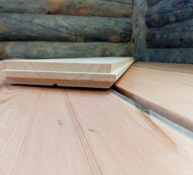 Kelosta valmistetun lattialankun päätypontti.